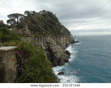 An Amazing Small Waves From The Sea Of Portofino After Rain And Some Big Rocks