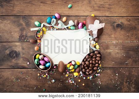 Happy Easter Frame With Greeting Card With Space For Text,  Chocolate Eggs,  Ribbon Bows And Candies