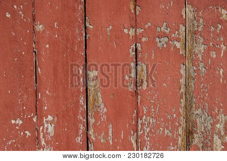 Texture Of Old Wood With Cracked Paint Of Red Color