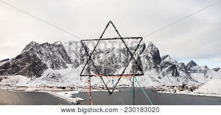 Star Of David On The Top Of A Hill With Beautiful Mountains On The Background, Lofoten Island, Norwa