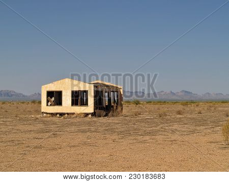 An Abandoned Home Alone In The Vast Desert Of Harquahala Valley Arizona. In The Distance Are The Eag