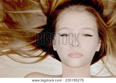 Beautiful Fashion Model Young Woman Portrait With Long Straight Hair. Natural Neutral Colors
