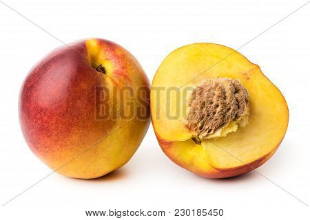 Ripe Nectarine And Half On A White Background.isolated