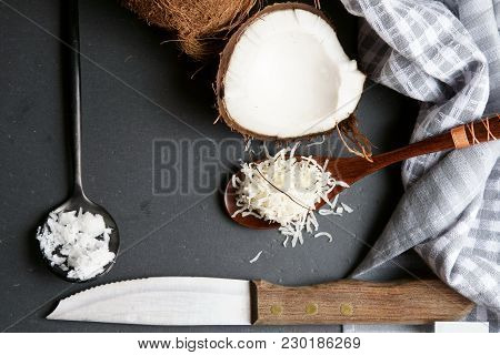 Top Down View Of Coconut Oil, Coconut Flakes On Grey Stone Background.