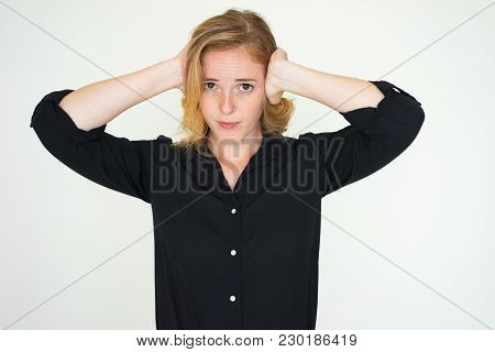 Annoyed Young Woman Covering Ears From Loud Noise. Serious Unhappy Lady Irritated With Noise. Ignora
