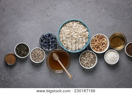 Ingredients For Cooking Homemade Granola: Oatmeal, Raisins, Coconut Chips, Honey, Peanuts, Cocoa, Bl