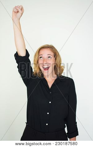 Emotional Excited Girl Raising Hand In Fist Up And Pretending Like She Flying. Happy Young Woman Fee