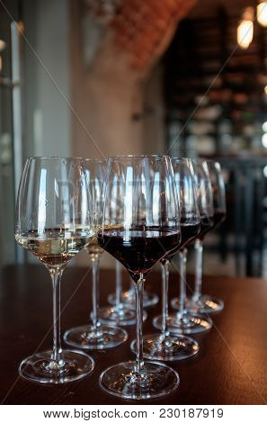 Glasses With White Wine And Red  In A Restaurant