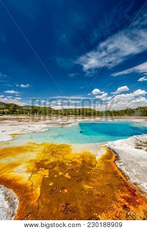 Hot thermal spring Sapphire Pool in Yellowstone National Park, Biscuit Basin area, Wyoming, USA
