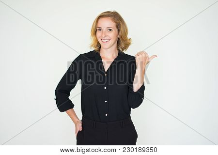 Positive Successful Business Lady Recommending Product And Showing Aside. Cheerful Confident Young W
