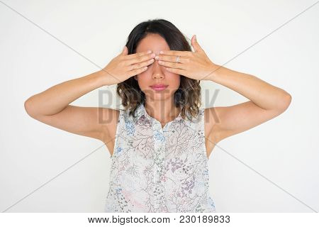 Serious Calm Woman Covering Eyes With Hands While Preparing To See Gift. Asian Girl Playing Hide-and