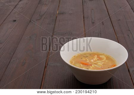 Bean Soup With Noodles On A Wooden Background