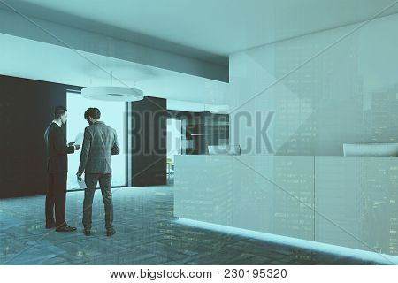 White Office Reception Desk With Two Computers Standing In A Modern Company Headquarters. A Side Vie
