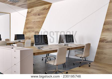 Marble Open Space Office Environment With Wooden Tables, White Chairs And Mock Up Computer Screens.
