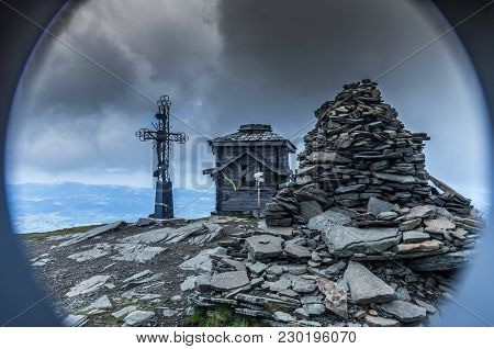 Crypt On The Mountain. A Spiritual Place For The Faithful. Peak. Stones And Clouds.