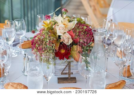 Centerpiece At An Autumn Winery Wedding Reception In California With Candlelight For A Dramatic, Rom