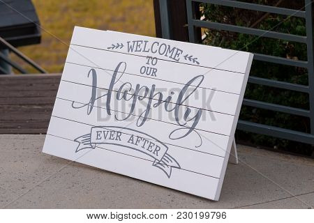 Sign At A Wedding Reception And Ceremony Reads Welcome To Our Happily Ever After.