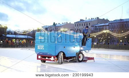 Saint-petersburg, Russia - January 07, 2018: Rink Employee Cleans And Leveles Surface Of Ice With A
