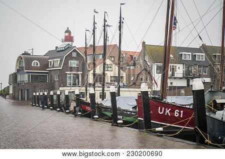 Urk, Netherlands - January 4, 2018: Old Smacks In The Harbor Of Urk On A Misty And Rainy Winter Day.