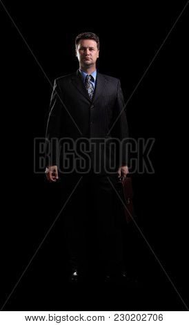in full growth.confident businessman with briefcase