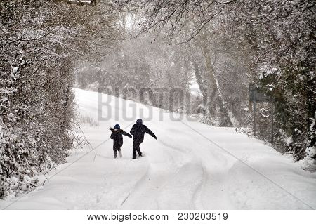 Bannow County Wexford Ireland - March 2 2018; Couple Playing On Winter Road Covered In Snow.