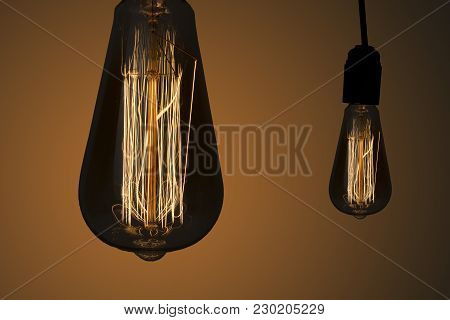 Vintage Hanging Edison Light Bulbs Over Dark Background