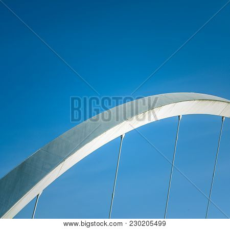 Abstract Architecture Detail Of A Section Of A Suspension Bridge With Blue Sky And Copy Space