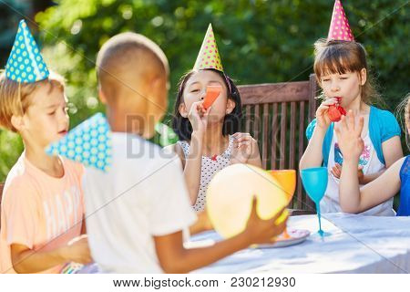 Children celebrate together and have fun at birthday party