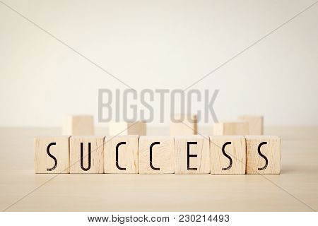 Sucess Word On Wooden Cubes Background, Business Concept