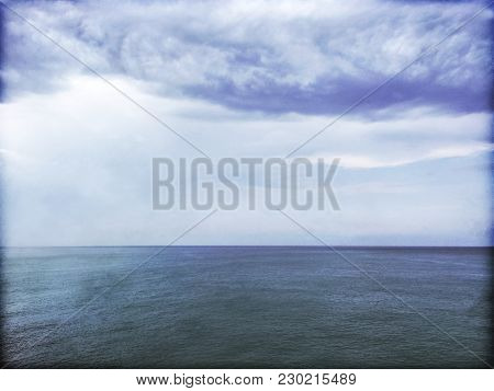 Grungy Image Of Stormy Sea And Clouds. Gloomy Dark Sky And Water.