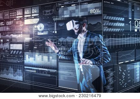 Virtual Reality. Clever Progressive Young Programmer Wearing Convenient Virtual Reality Glasses Whil