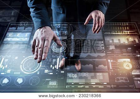 Careful Work. Calm Elegant Professional Programmer Touching A Futuristic Transparent Device While Lo