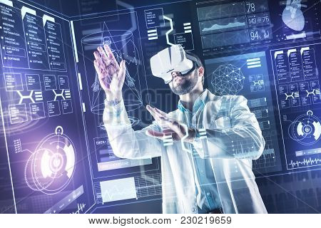Careful Touch. Smart Experienced Progressive Doctor Carefully Touching The Transparent Screen While