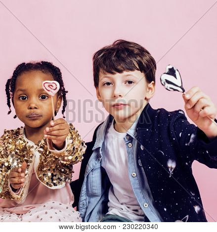 Lifestyle People Concept: Diverse Nation Children Playing Together, Caucasian Boy With African Littl