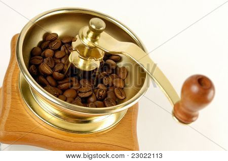 Stock photo of a Coffee grinder with coffee beans close-up Isolated over white background