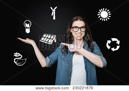 Good Idea. Cheerful Clever Smiling Woman Feeling Excited While Suggesting The Way Of Using Alternati