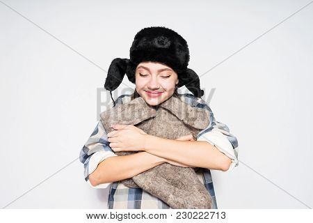 Russian Girl Holding Felt Boots On Gray Background