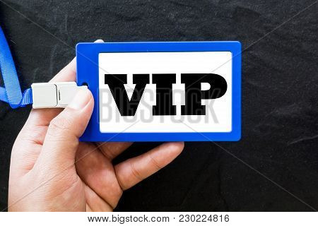 Hand Holding Vip Id Card On Black Background