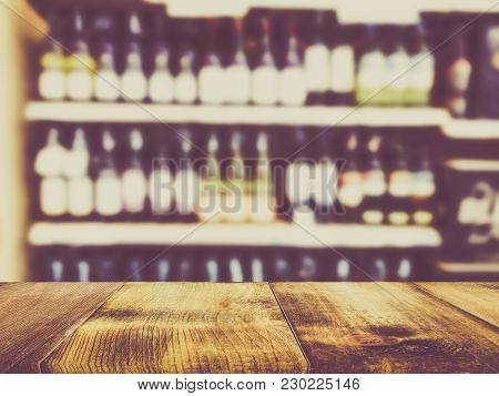 Wooden Counter Product Display With Wine Liquor Bottle On Shelf, Blurred Background