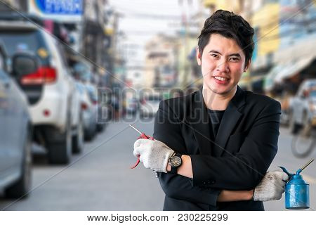 Asian Men Wearing Suits With Repair Equipment On Car Street And Traffic Blurred Background. For Auto