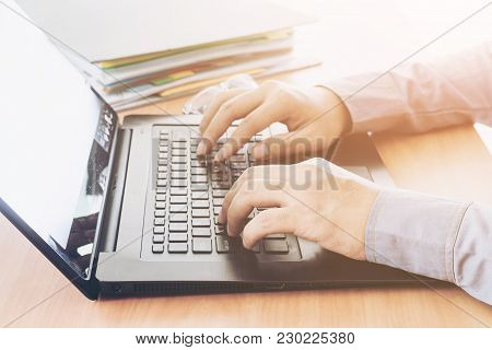 Businessman Using Laptop At Office Desk Table