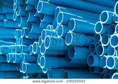 Selective Focus Of Blue Pvc Pipes In Warehouse