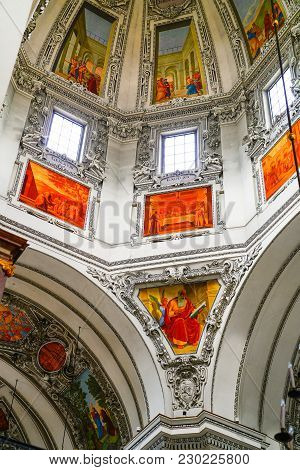 Salzburg, Austria - September  6 2017; Religious Frescos High Up In Dome Of Cathedral.