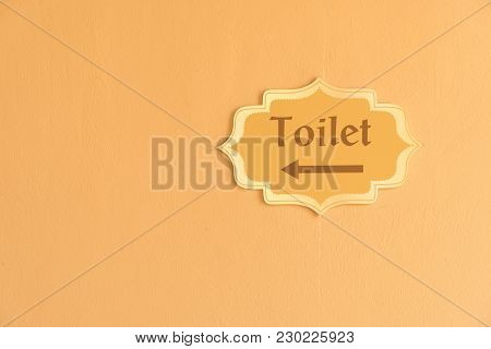 Public Restroom Signs With Arrow, On Cement Background