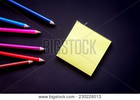 Paper With Crayon On A Black Backgrounds