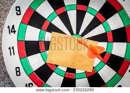 Blank  Paper At The Center Of Dart Aim