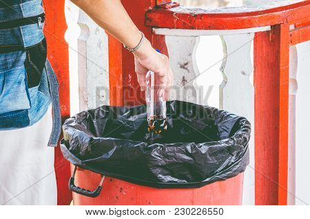 Hand Throwing Bottle In Trash Cans Outdoor