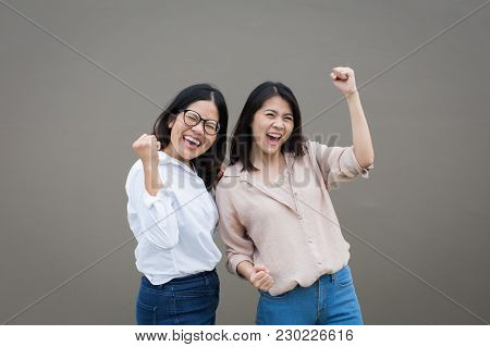 Young Asian Women Friendship Concept With Smiling Women Holding Hands