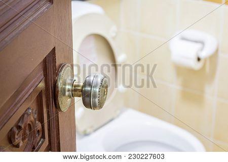 Opened Door With A Toilet Room Interior