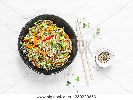 Pad Thai Vegetarian Vegetables Udon Noodles In A Light Background, Top View. Vegetarian Food In Asia